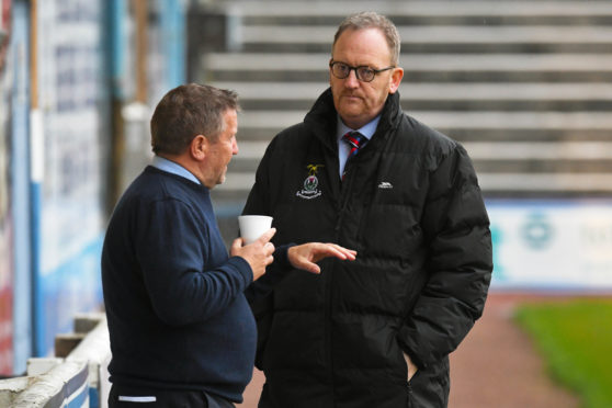 Scot Gardiner and Caley Thistle manager John Robertson (left)