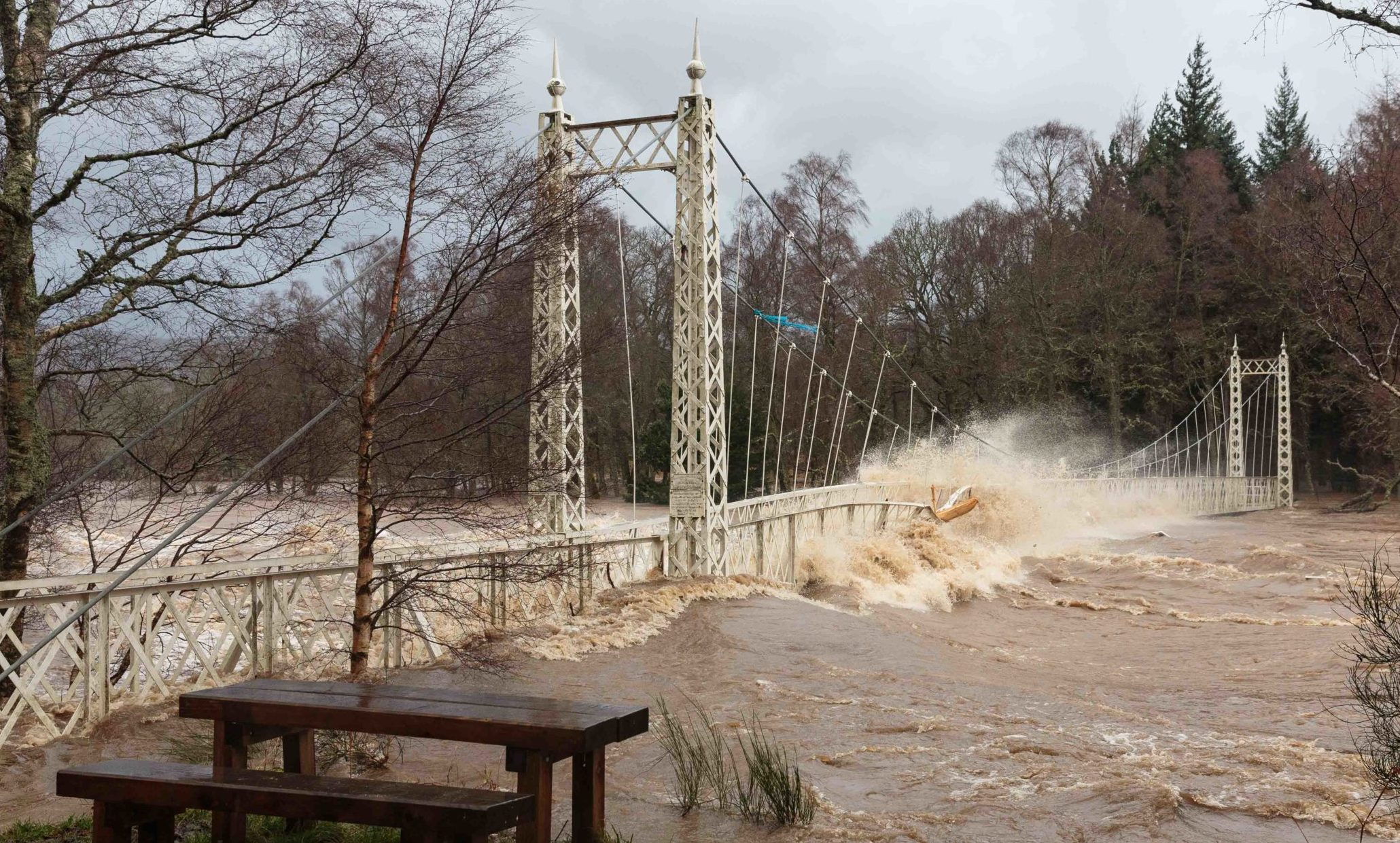 The Cambus O'May footbridge over the River Dee during Storm Frank in 2015
