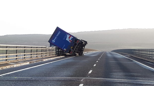 The HGV was travelling southbound on the A9 on the Dornoch Bridge when it toppled over due to high winds.