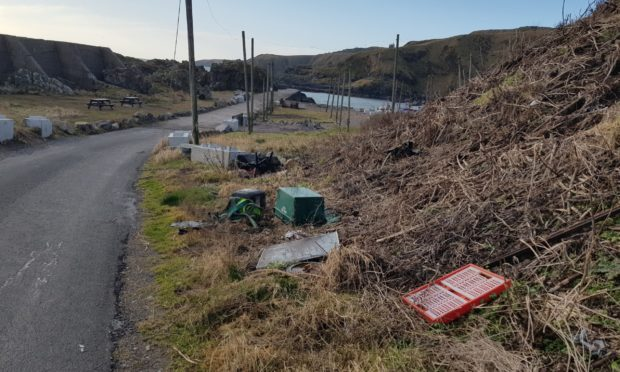 Plastic boxes and office chairs have been dumped at Cove Harbour.