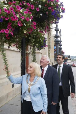 Previous Town House flowers being admired by provost Helen Carmichael