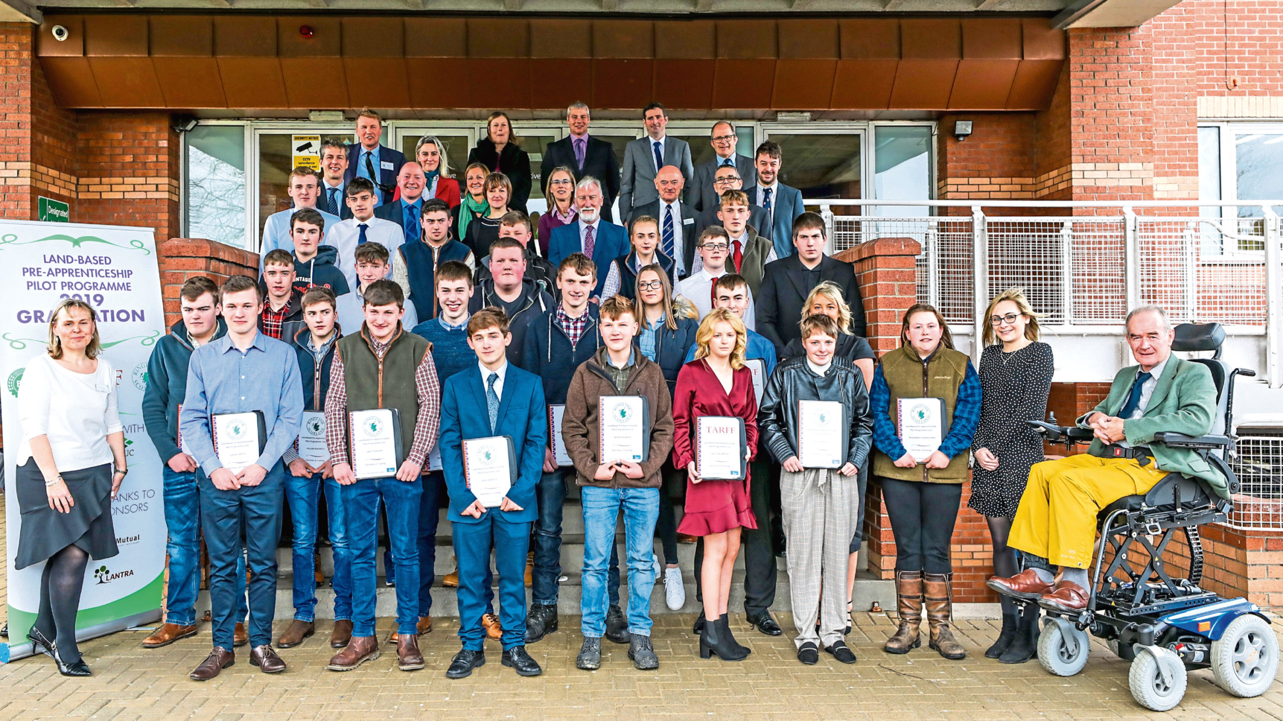Pilot scheme pre-apprenticeship students and their mentors at the graduation ceremony which was held in Perth.