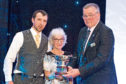 Jan Innes and son James collect the award from NFU Scotland president, Andrew McCornick, on the right.