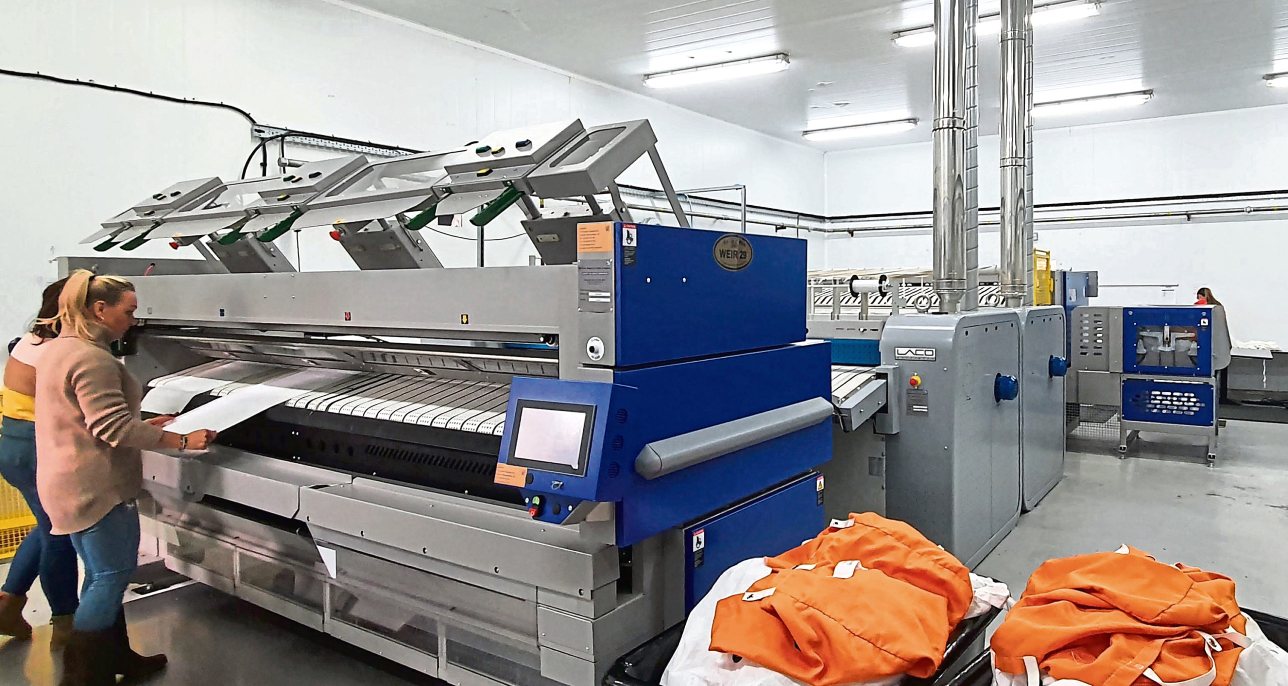 Commercial laundry firm MacKleeners has installed a new industrial iron to increase capacity, productivity and service quality.