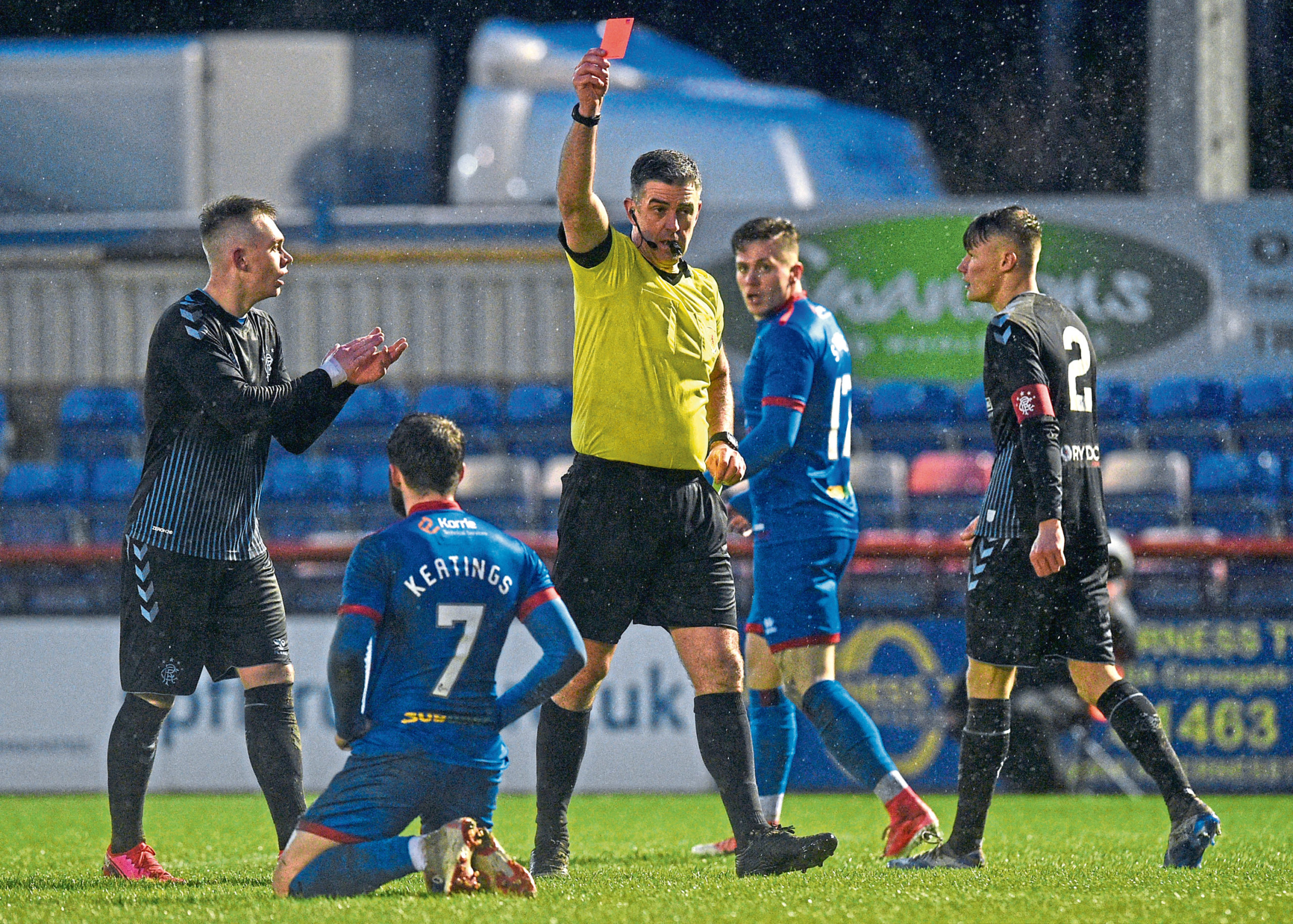 Inverness' James Keatings is shown red by referee Greg Aitken for simulation during the Tunnock's Caramel Wafer Cup semi-final between Inverness Caledonian Thistle and Rangers Colts.