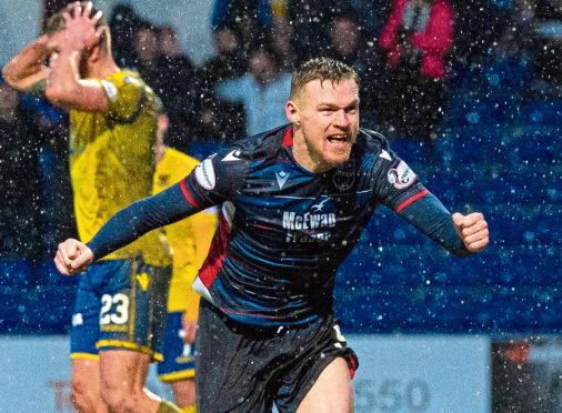 Ross County's Billy McKay celebrates after scoring to make it 1-1 during the Ladbrokes Premiership match between Ross County and St. Johnstone.