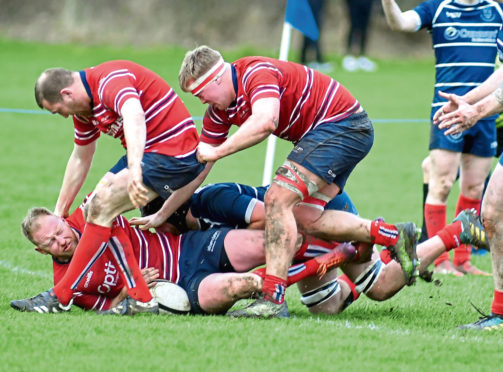 Aberdeen Grammar (red) in action against Musselburgh.