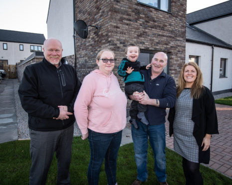 L-R: Allan Liddle, Development Officer Osprey Housing Group, Patricia Logie, Reece Logie, Kevin Logie and Stacy Angus, Osprey's Housing Services Manager