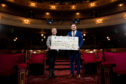 Cheque hand over, from Aberdeen Performing Arts to the Archie Foundation, with funds raised from 2019's pantomime. Pictured is Chief Executive, Jane Spiers and Jamie Smith from the ARCHIE Foundation at His Majesty's Theatre.