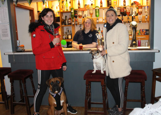 Karis and Megan Burns with barperson Yvonne Anderson at Balta Light Pub in Unst.