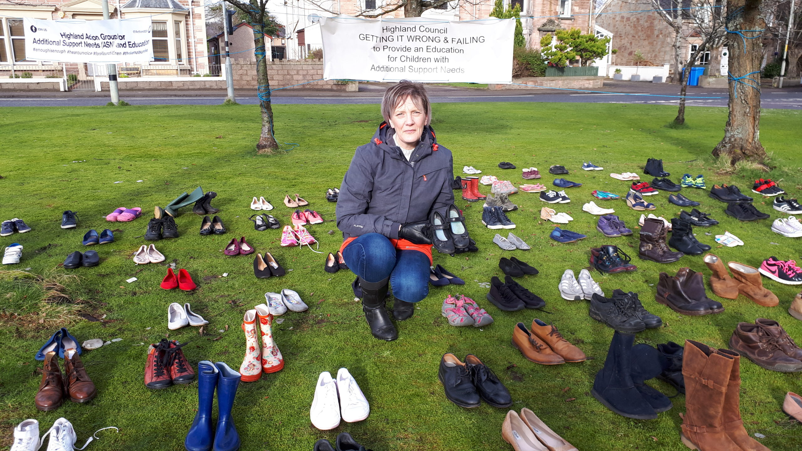 Barbara Irvine surrounded by show representing 235 children receiving less than half a full time education in Highland.