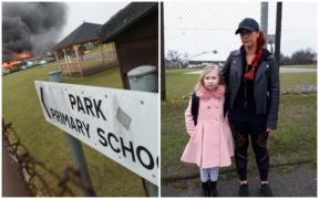Cathleen Heine and her daughter Rose outside fire damaged Park Primary.