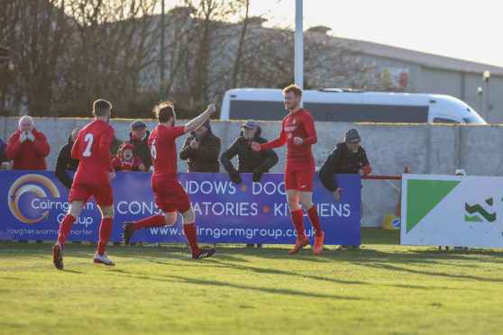 Brora's Greg Morrison celebrates as he opens the scoring.
