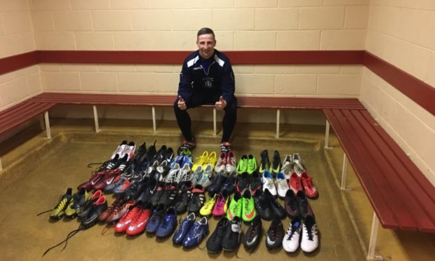 Christopher Adams with the football boots