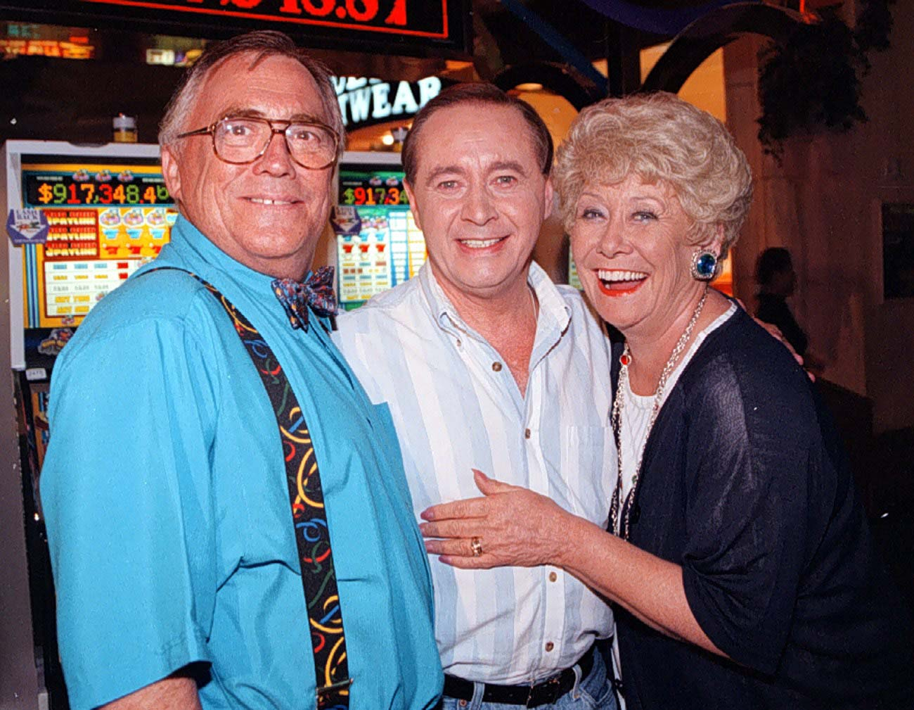 """File photo dated 23/09/1997 of Coronation Street actors, Jack (left) and Vera Duckworth played by Bill Tarmey and Liz Dawn with Street veteran Ray Langton, played by Neville Buswell (centre) as they meet in Las Vegas during the filming of a special Coronation Street video. Coronation Street has paid tribute to actor Neville Buswell, saying it was """"saddened"""" to hear of his death. PA Photo. Issue date: Monday January 27, 2020. The former star of the soap died on Christmas Day 2019 at the age of 76. The cause of death is not known. Buswell, who played Ray Langton in Weatherfield for 10 years, is thought to have died in Las Vegas, where he lived. See PA story DEATH Buswell. Photo credit should read: Dave Kendall/PA Wire"""