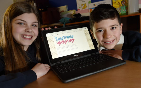 Pupils Katie Cameron and Lucca Williams, both of Primary 7 at work on their computers.  Picture by Sandy McCook.