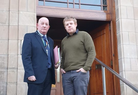 Derek Ross and Tim Eagle outside the Moray Council office