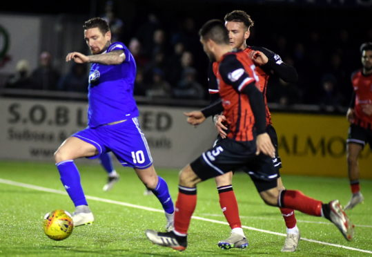 Martin Scott in action for Cove Rangers against Elgin City.
