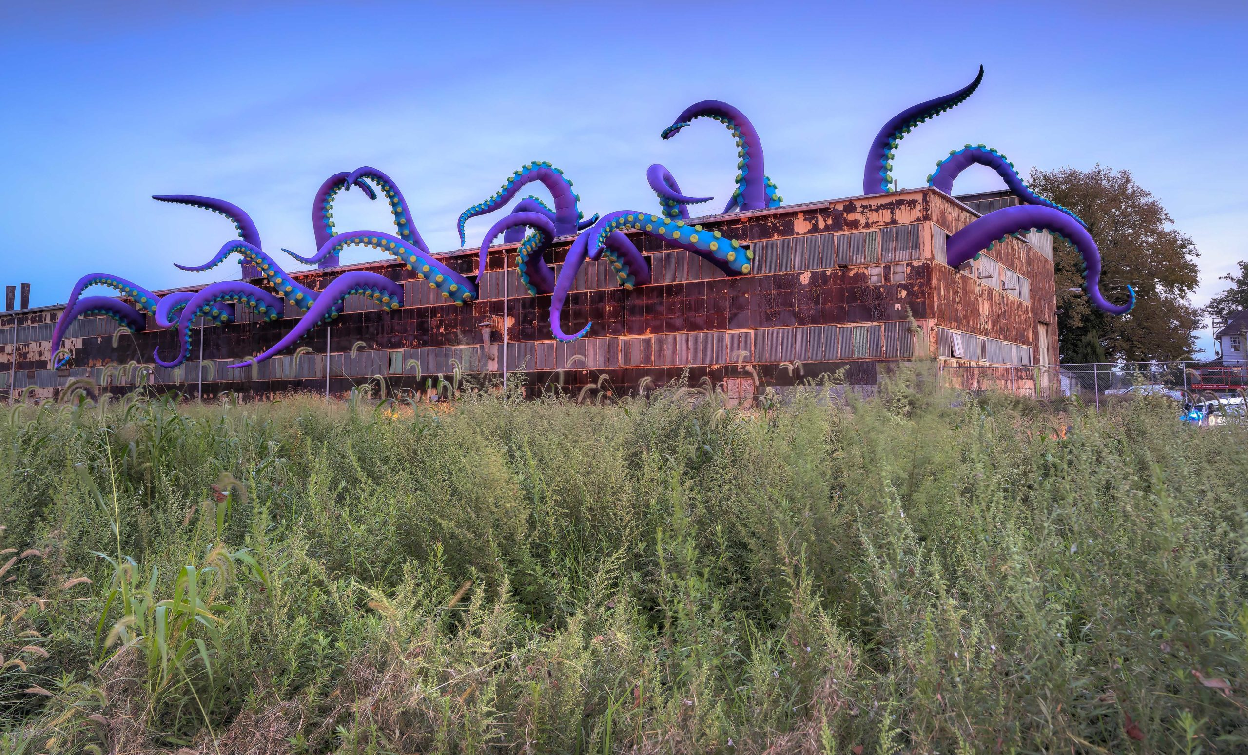 Giant tentacles sticking out of the Navy Yard in Philadelphia, created by Designs in Air