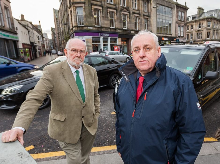 Andrew Macdonald of the Inverness Taxi Alliance  and Steve Cairns, taxi driver at rank in Inverness City Centre.