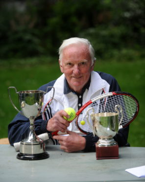 Jimmy Wood with some of his trophies.