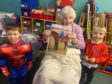 Emily McIntosh with two pupils from Forehill Nursery.