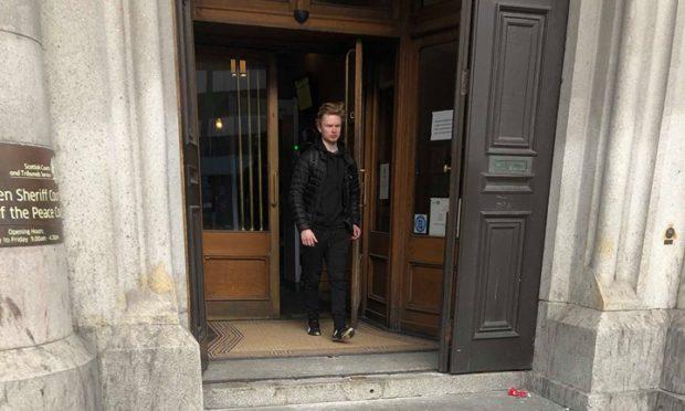 Kamil Lebek leaving Aberdeen Sheriff Court
