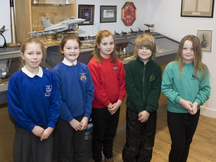 STEM winners are shown around II(AC) Squadron. Left to right – Ruth from Burghead Primary School, Isla from St Sylvester's RC Primary School, Rebecca from Craigellachie Primary School, Felix from Dyke Primary School, Lucy from Botriphinie Primary School.