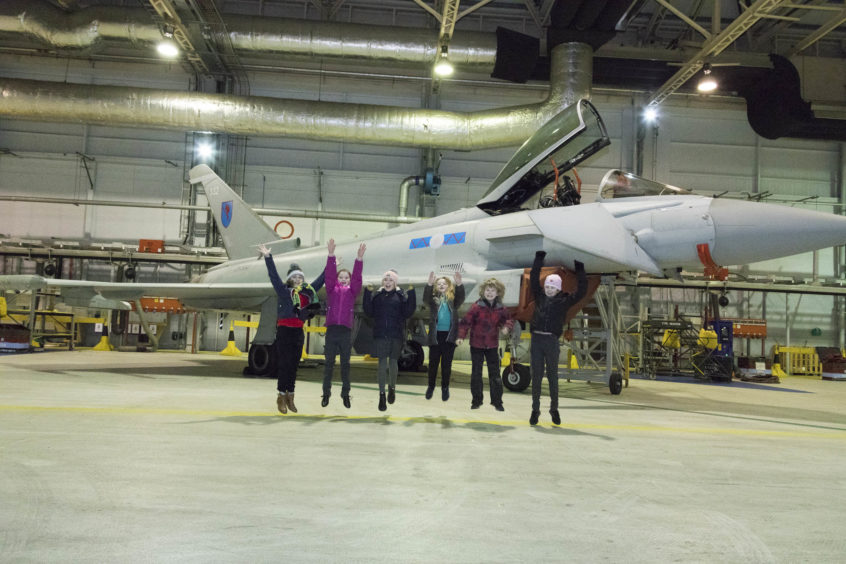 Takeoff! STEM winners having fun in front of one of the Typhoons