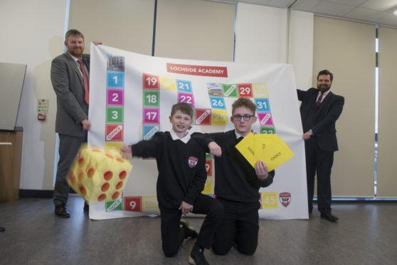 Lochside Academy Headteacher Colin Hendry with pupils Sean Paul Gordon and Kai McLaughlin and Councillor John Wheeler.