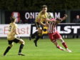 Luc Bollan jumps with with Formartine's Garry Wood.   Picture by Kath Flannery