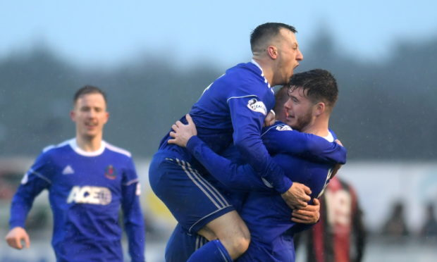 Cove's Daniel Higgins celebrates his goal.  Picture by KATH FLANNERY