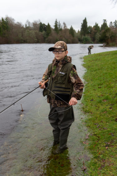 10-year-old James Stewart fishes on the River Ness after the opening of the season. Picture by Jason Hedges