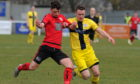Wick Academy's Gary Manson (right) in action against Inverurie Locos