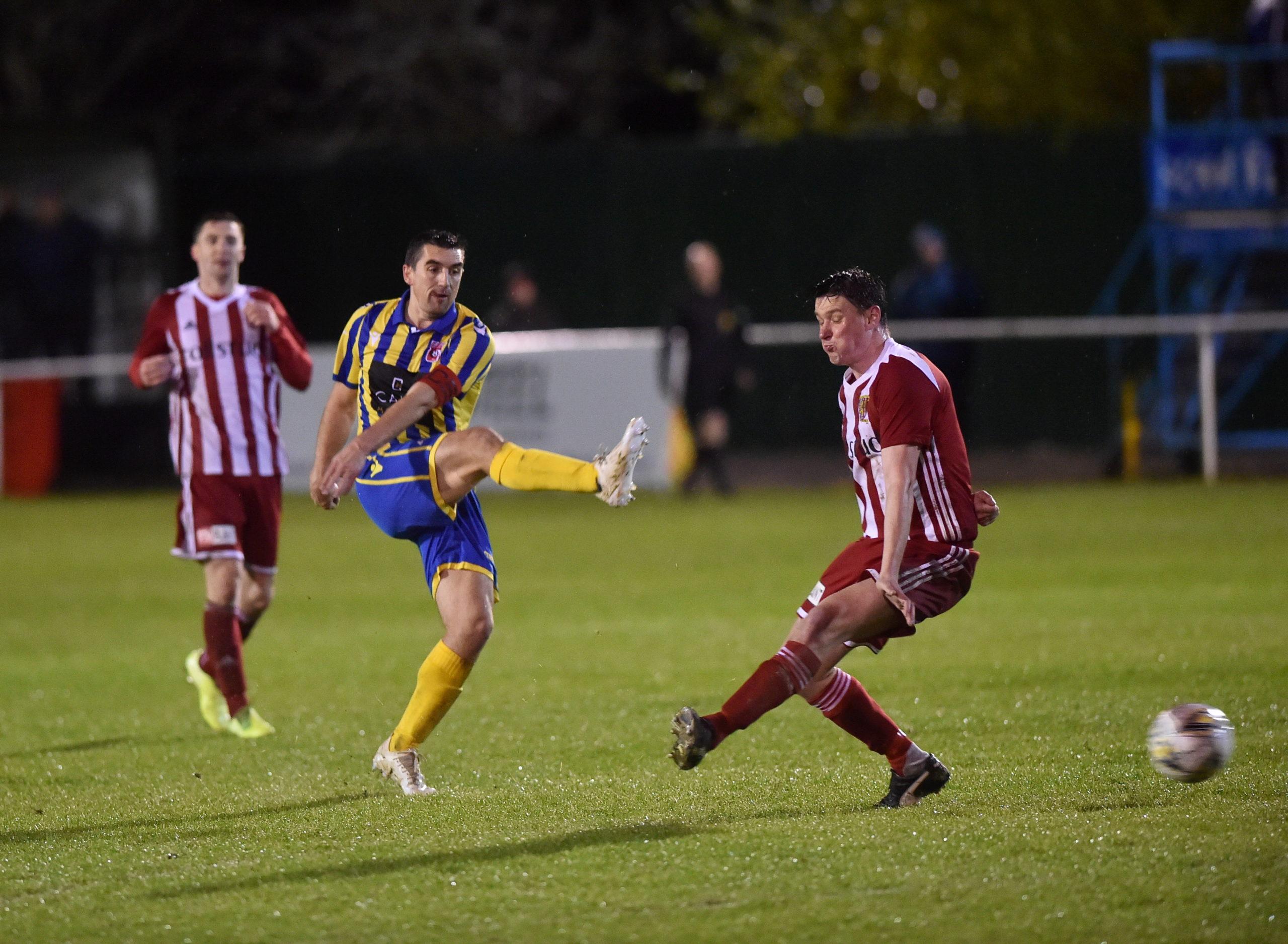 Locos captain Neil McLean, centre has a shot on goal. Picture by Scott Baxter