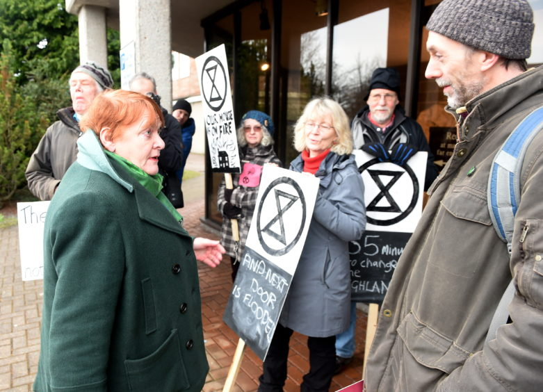 Climate activists protest outside the Highland Council headquarters in Inverness. Picture by Sandy McCook.
