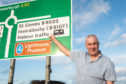 The sign on the entrance to Fraserburgh on the A90 from Peterhead shows the incorrectly spelt word Harbour. Coucillor Brian Topping is pictured with the sign.  Pictures by JASON HEDGES