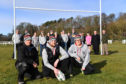 (L TO R) ANDY MCDONALD, JOHN HESTER AND LYNDSEY HESTER AT THE  NEWLY ERECTED RUGBY POSTS AT THE HAUGHS, TURRIFF,WITH MEMBERS OF THE TURRIFF RUGBY CLUB AND LOCAL COUNCILLORS.