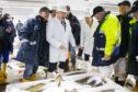 Boris Johnson during a visit to Peterhead fish market.