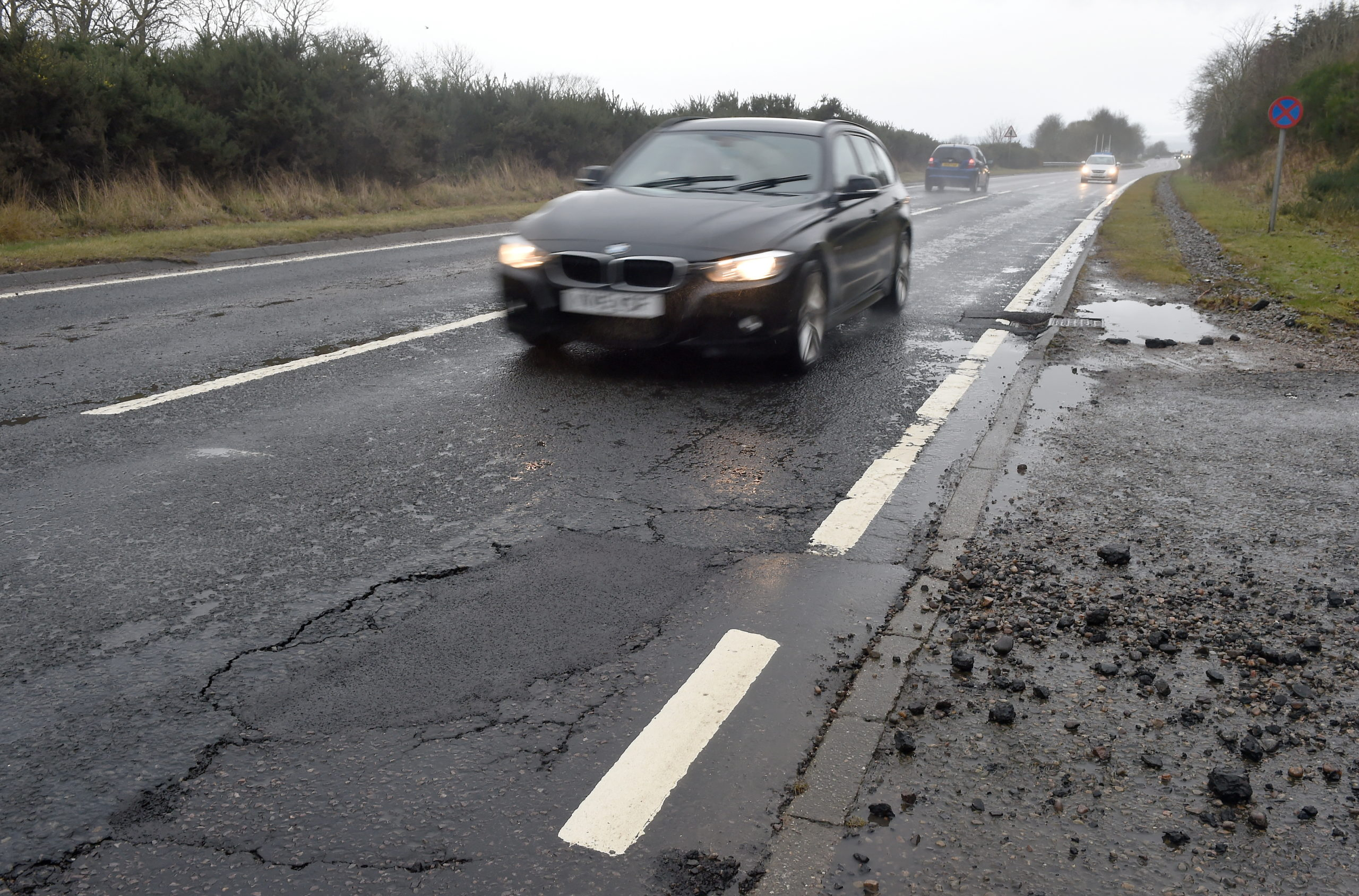 Picture by SANDY McCOOK  14th February '20 The sectiin of the  A9 north of the Storehouse of Foulis following a series of breakdowns on Thursday evening with vehicles being damaged by a large pothole. Fresh tar marks the area of the pothole yesterday morning.(Fri)