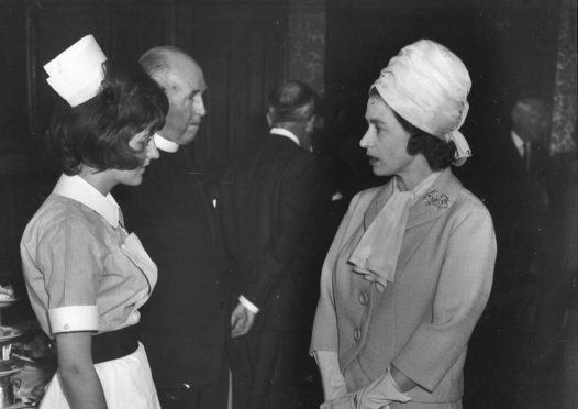 """""""The Queen meets Nurse Margaret Pauline during her visit to Aberdeen to sound the """"all clear"""" in the typhoid epidemic"""" Press and Journal Copyright."""