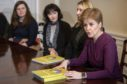 First Minister Nicola Sturgeon with care review representatives in the Cabinet Room at Bute House, Edinburgh, following the publication of the Independent Care Review report.