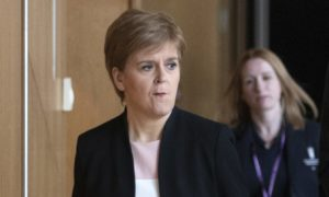 A tense-looking Nicola Sturgeon arriving to give her statement on Derek Mackay ahead of FMQs.