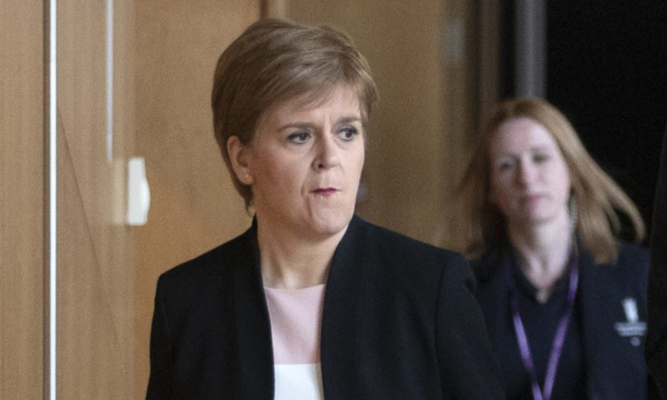 First Minister Nicola Sturgeon arrives at the debating chamber ahead of FMQs at the Scottish Parliament in Edinburgh.