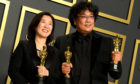 Bong Joon-ho (right) and Kwak Sin-ae with their Oscars for Best Original Screenplay, International Feature Film, Best Director, and Best Picture for Parasite in the press room at the 92nd Academy Awards held at the Dolby Theatre in Hollywood, Los Angeles.