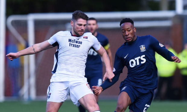 Ross County's Iain Vigurs battles with Nicke Kabamba.