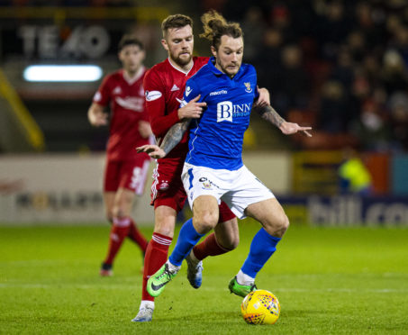 Michael Devlin challenges St Johnstone's Stevie May