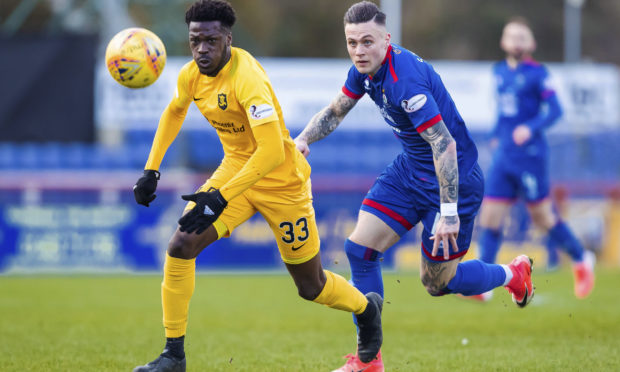 Miles Storey chases down Livingston defender Steve Lawson.