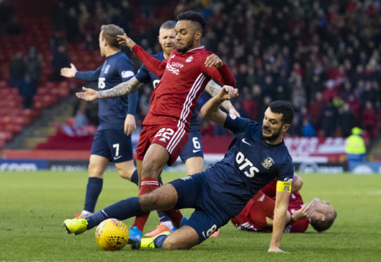 Aberdeen's Funso Ojo is challenged by Kilmarnock's Gary Dicker during Saturday's fifth round tie.