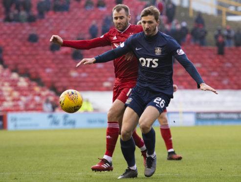 Kilmarnock's Dario Del Fabro and Aberdeen's Niall McGinn, behind.